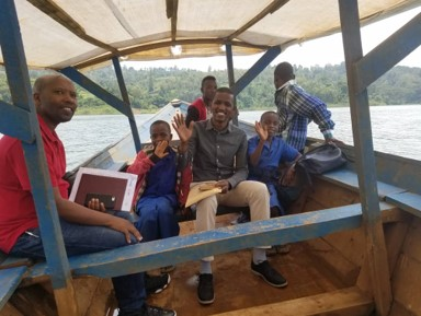 Study team travelling by boat to one of the study sites, Rusizi, Rwanda. Photo: PROFORMA